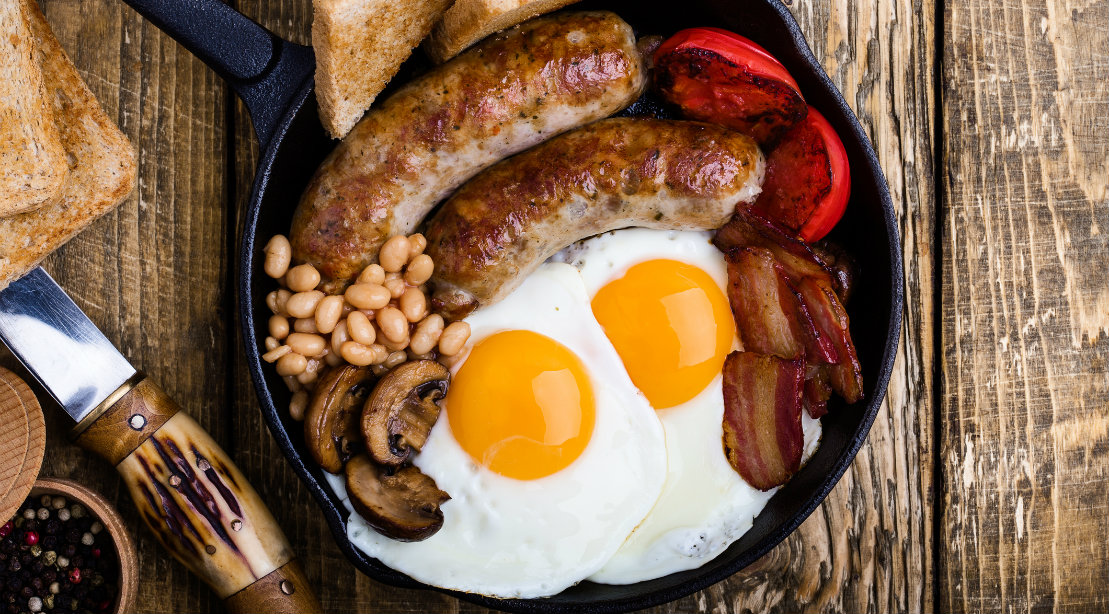 Eggs and sausage in skillet