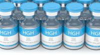 Vials of human growth hormones and hgh vials in a line