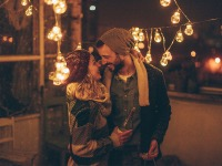 Couple Kiss During the Holidays