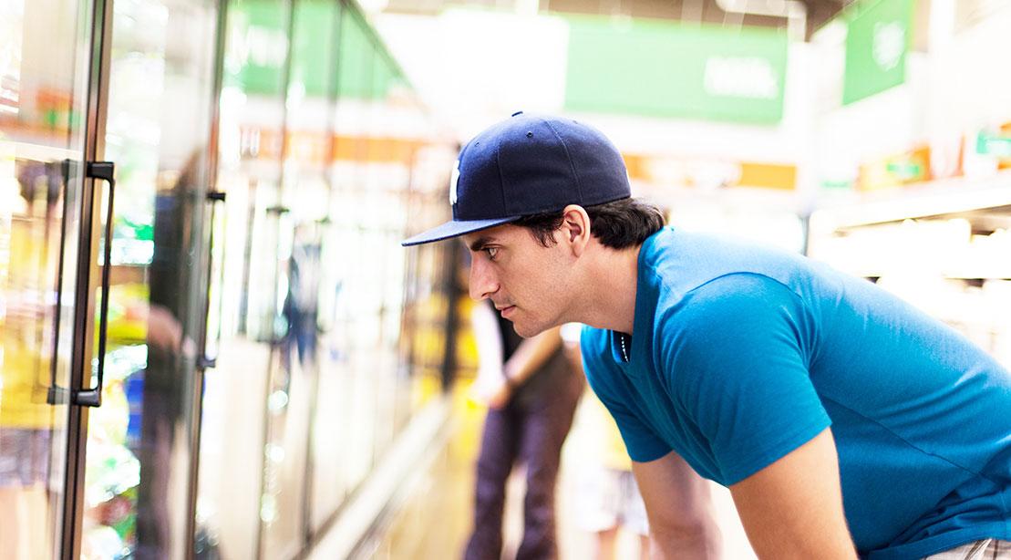 Man Looking at Freezer