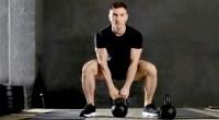 Man-Wearing-Black-Shirt-Squat-Position-Deadlifting-With-Kettlebell