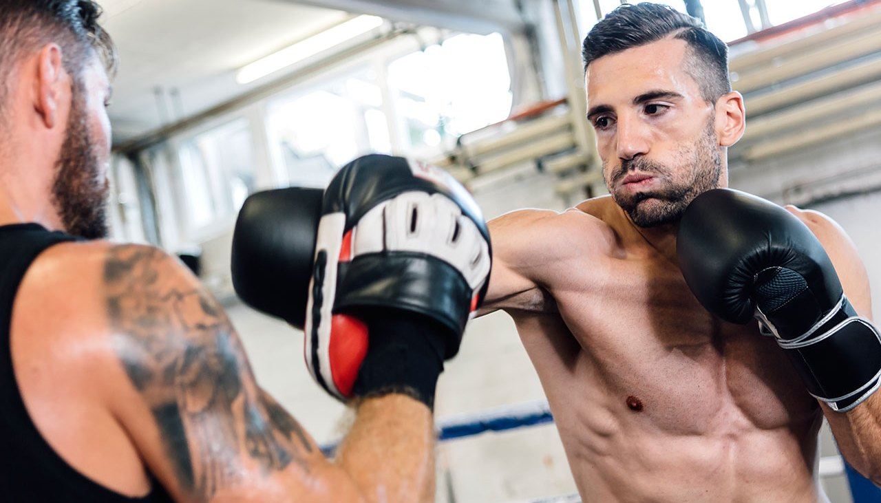 Muscular Boxer Sparring with a training partner during a boxing class