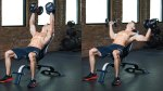 Muscular fit male working out his chest muscles with an incline dumbbell flye chest exercise