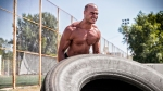 Shirtless Man Workout With Tire