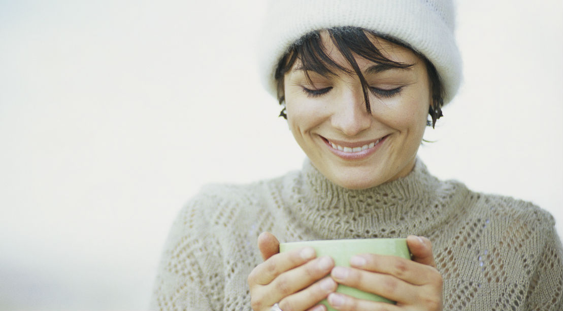 Woman Drinking Out of a Mug