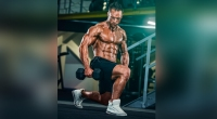 Bodybuilder performing dumbbell lunge