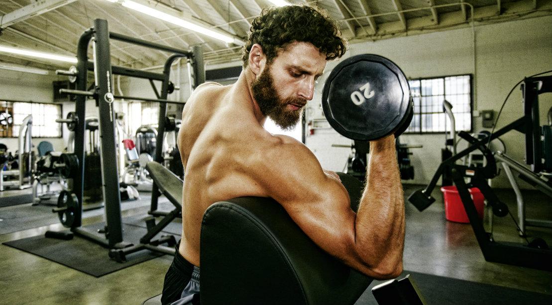 Dumbbell preacher curl for biceps