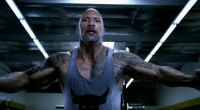 Dwayne The Rock Johnson performing chest exercise