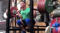 John Cena performing squat at gym