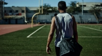 Man Walking to Field With Gym Bag