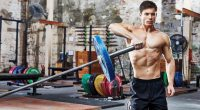Muscular man working out his shoulders with a landmine shoulder pressit to Improve Mobility and Boost Strength