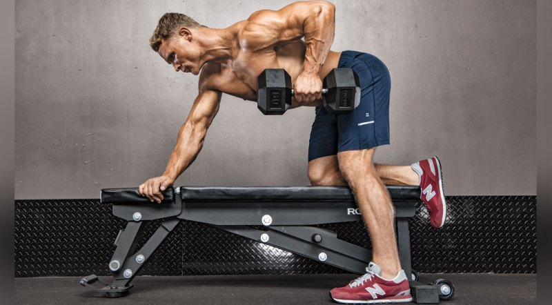 Bodybuilder working out his arms with a fat grip dumbbell row exercise