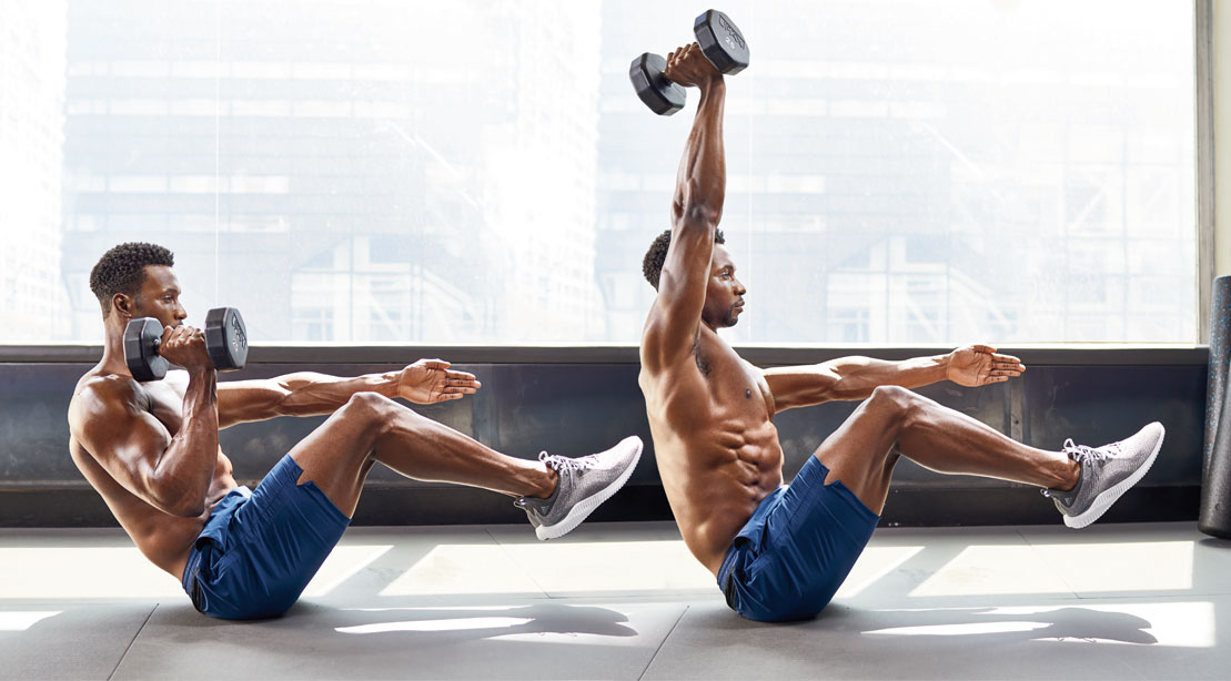 Physically fit fitness model and bodybuilder demonstrating how to do the V-Sit Press