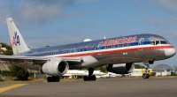 An American Airlines flight forced to land early due to passenger doing pull ups