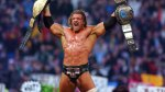 Triple H holding the WWE World Title