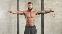 Athletic Man Doing Resistance Band Pull-apart