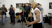 Boxer Floyd Mayweather training by jumping rope in a boxing gym