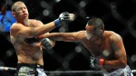 Dan Henderson connects with a right to Mike Bisping