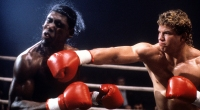 Tommy Morrison is hit in a scene from the film 'Rocky V', 1990.