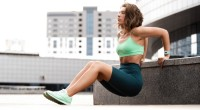 Woman Doing Triceps Dips Outside