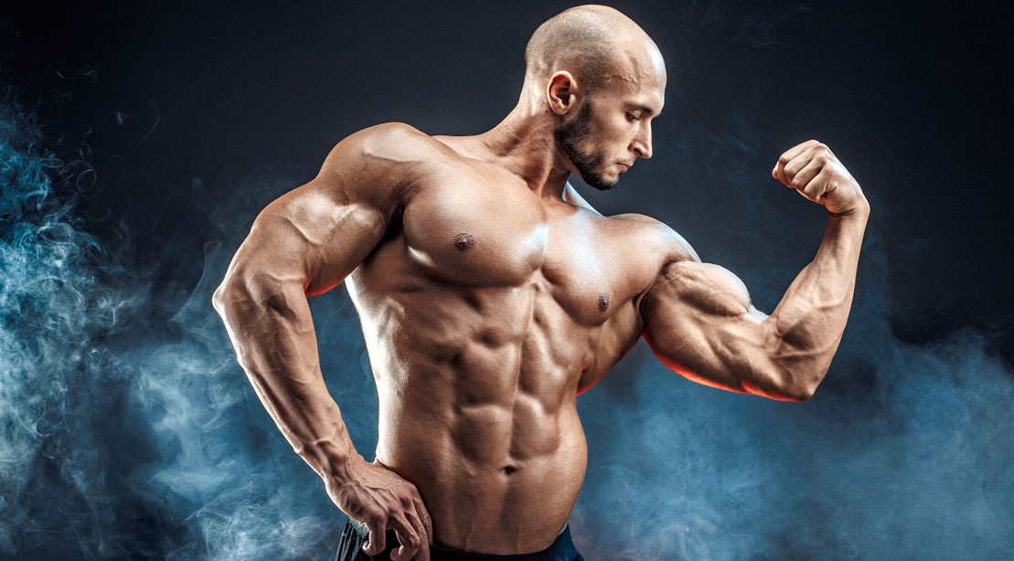 Bald muscular bodybuilder with big biceps muscle