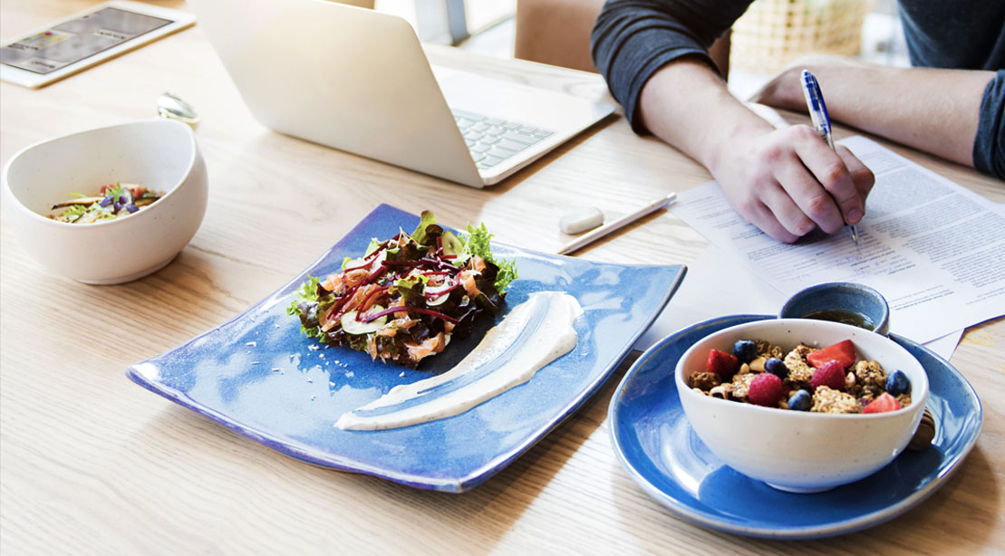 Man-Figuring-Out-How-To-Gain-Healthy-Weight-With-Three-Meals-On-A-Dining-Room-Table