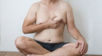 Man-With-Gynecomastia-Medical-Condition-Lifting-His-Left-Male-Breast