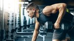 lifting-weights-with-headphones-615883260