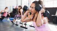 1109-Woman-Dumbbell-Overhead-Squat-GettyImages-922708878