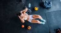 Woman doing crunches and circuit training