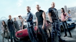 Gal-Gadot-Paul-Walker-Vin-Diesel-and-The-Rock-Standing-In-Front-of-Customized-Cars-For-Fast-and-Furious-Movie