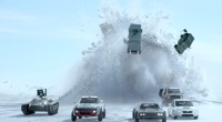 Ice and snow exploding with army cars in the air in the Fate of the Furious Fast and Furious 8 movie