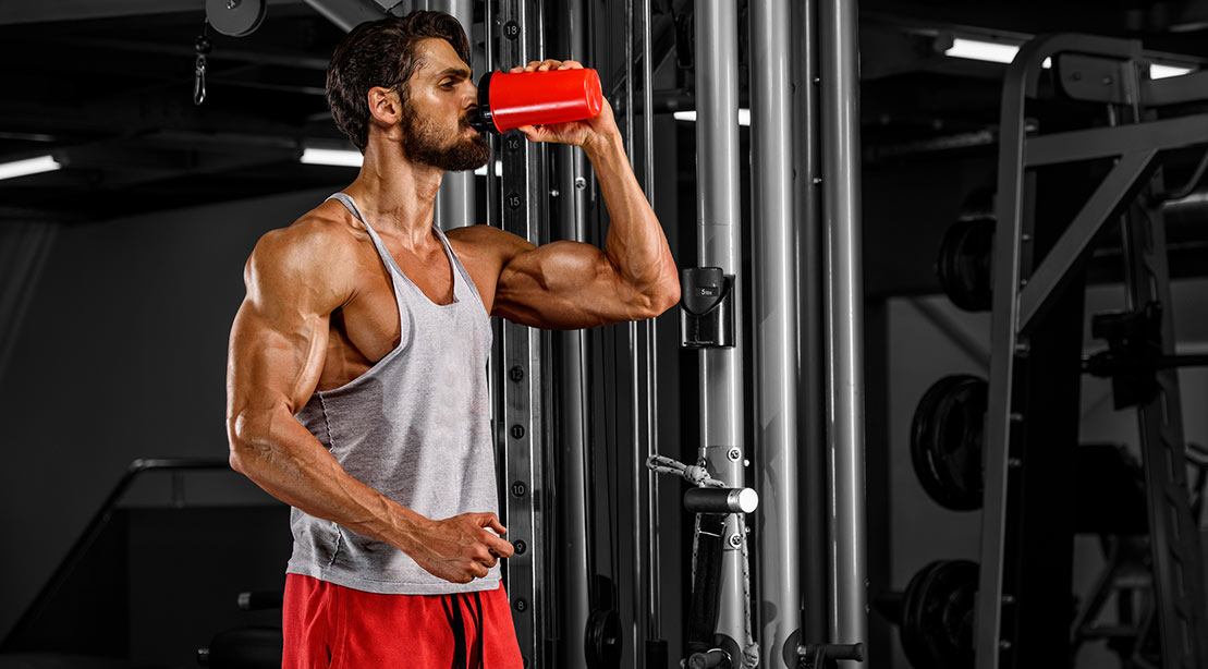 A picture of a man drinking a protein shake.