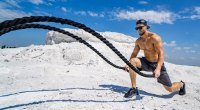 Physically-Fit-Man-Workingout-Outdoors-On-A-Mountain-Doing-Battle-Rope-Exercises