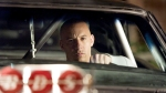 Vin Diesel holding the steering wheel of a customized Dodge Charger