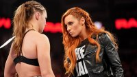 Becky Lynch staring down Ronda Rousey.