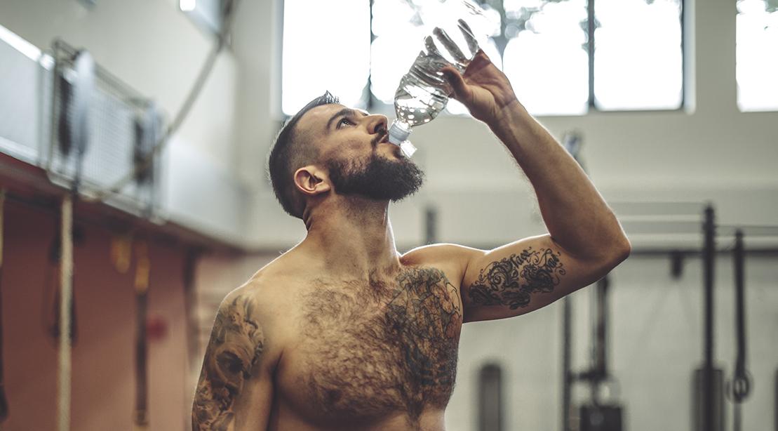 Shirtless Man Drinking Water
