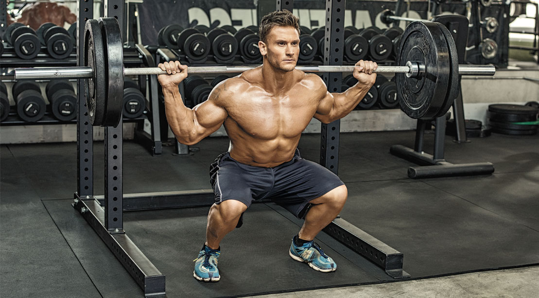 Bodybuilder performing the compound exercise the squat