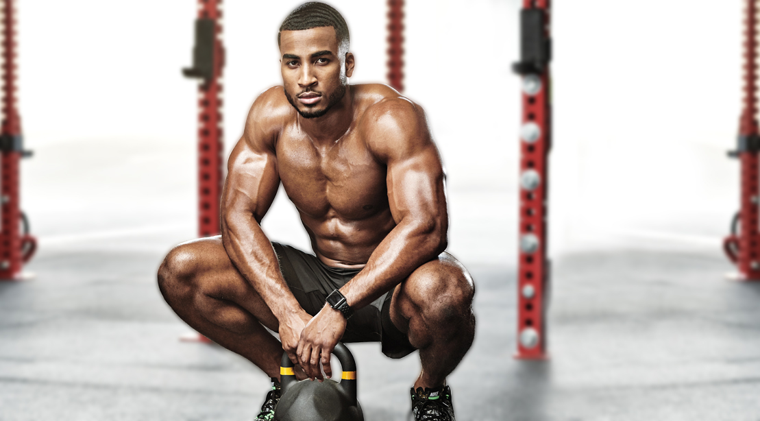 Fitness model squatting in the gym