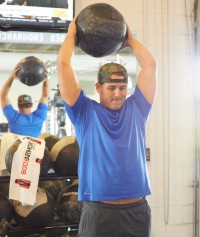 Cubs star Anthony Rizzo exercising with a medicine ball.