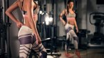 Female fitness model wearing tight yoga pants looking at her butt in the mirror