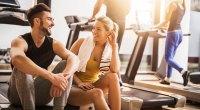 Man and woman flirting at gym