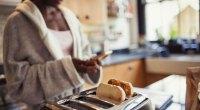 Woman making toast breakfast