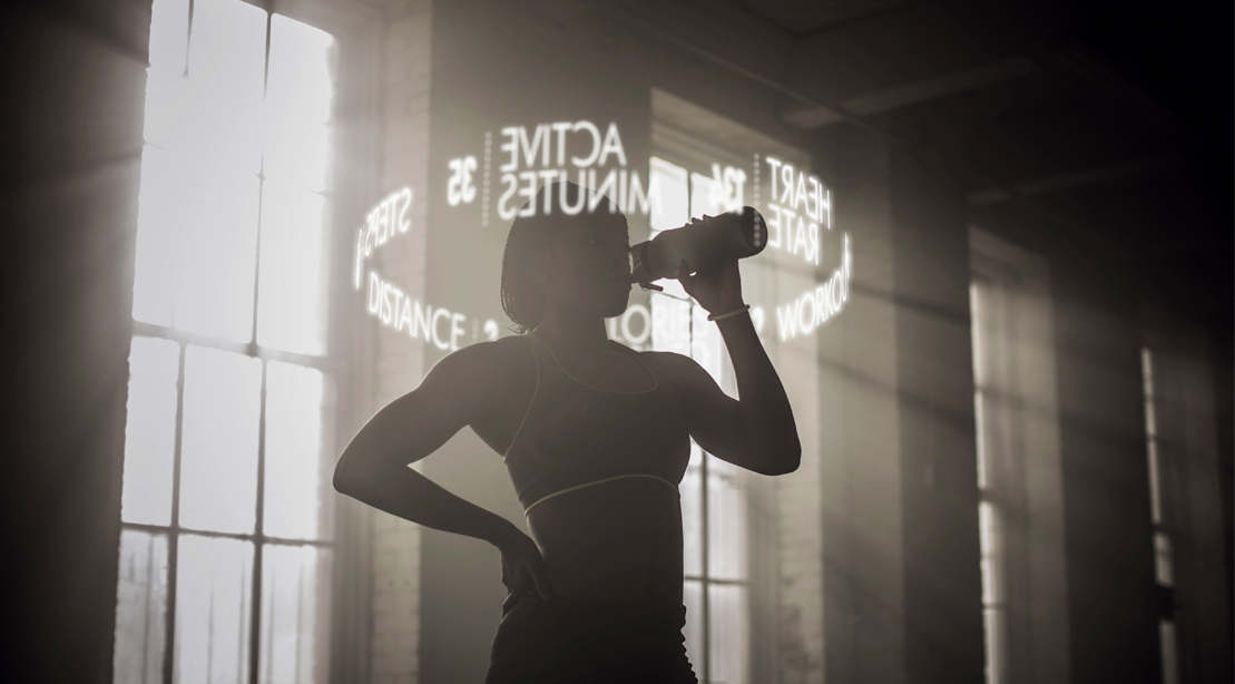 Fit female drinking water after her workout with names of supplement