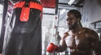 Boxer-Hitting-Heavy-Bag-Boxing