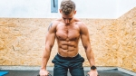 Man Preparing for the Push-ups on Kettlebells in Gym