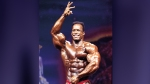 Bodybuilder Shawn Ray posing on stage