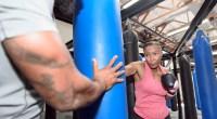 2woman-boxing-heavy-bag-1109