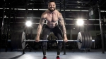 Bodybuilder deadlifting heavy weights