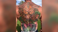 Six-time Mr. Olympia Dorian Yates shows off his new back tattoo.